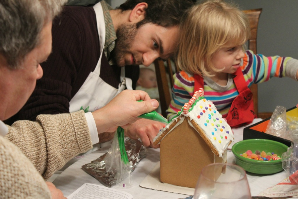 While the cookies were baking, Jarryd and Dad helped Julia make a gingerbread house. I like how you can see sleeping Grant in this photo too.